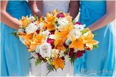 little miss lovely floral design // McCarthy Imagerie // Ocean City Maryland Tropical Beach Wedding Bouquets // orange lilies, hot pink ranunculus, white roses, white orchids, teal calla lilies
