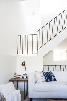 Modern Metal Railings + A Sleek Staircase Design Metal railings instantly elevate a staircase design! Check out the before and after of our modern metal makeover and why we went vertical! Metal Stairs, Metal Railings, Staircase Railings, Modern Staircase, Staircase Ideas, Modern Railing, Spiral Staircases, Bannister, Painted Stairs