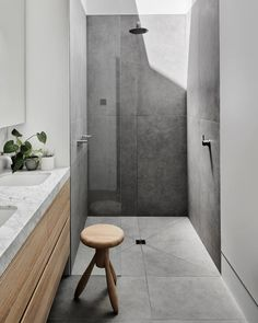 grey flooring Bathroom Shower Design // loving the light wood cabinets and how they cut the grey floor tile in this shower //