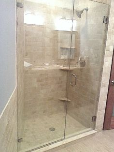 Custom inline frameless shower doors with niagara glass calgarys beautiful glass shower door ray sands glass installs glass shower doors planetlyrics Image collections