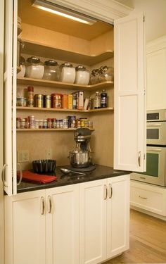 Would love to have a low marble countered baking center with plenty of outlets and shelf space for supplies as well as hooks for measuring spoons and cups.