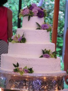 Beautiful Cake with purple and green live floral trim