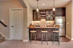 amazing basement bar. love the floors, the bar cabinets and the backsplash.