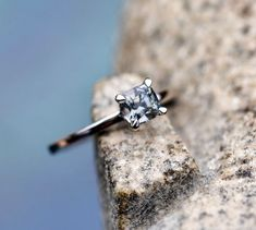 A 0,80 carat grey spinel set in 14K solid white gold