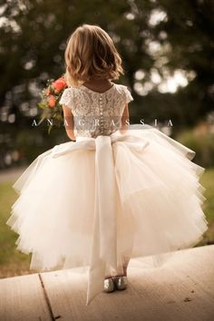 ANAGRASSIA flower girl dresses: ivory/champagne lace leotard & bodysuit with champagne/ivory/white tulle skirt and satin sash http://www.anagrassia.com