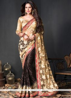 Spruce up the ethnic girl next door look robed in this cream and pecan color brasso net half n half sari. The lace, resham, sequins and stones work seems chic and best for any affair. Indian Designer Sarees, Indian Sarees Online, Buy Sarees Online, Blouse Online, Bridal Sari, Saree Wedding, Two Piece Long Dress, Wedding Sarees Online, Casual Saree
