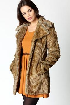 Faux fur coat. Never thought I would be into a fur coat but I totally dig it.
