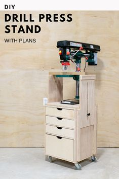 DIY Mobile Drill Press Stand You can build this mobile drill press stand with side supports for you shop. Full detailed how-to video and plans available! The post DIY Mobile Drill Press Stand appeared first on Werkstatt ideen. Woodworking Shop Layout, Woodworking Workshop, Woodworking Projects Diy, Woodworking Plans, Sketchup Woodworking, Woodworking Jigsaw, Woodworking Basics, Woodworking Techniques, Woodworking Furniture