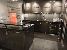 pictures of kitchens with ikea wood countertops | ... Ikea's Abstrakt glossy dark gray lacquer with black counter tops