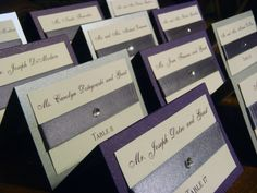 Elegant Wedding Place Cards- pretty with ribbon and jewel. Check out http://bigdaythewediquetteway.blogspot.com/2013/10/all-about-place-cards.html for Place Card help and inspiration.