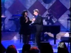 Barry Manilow and Debra Byrd do a fun take on Baby It's Cold Outside