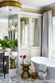 Gorgeous master bathroom with graphic floors and a free standing tub. Mathew Quinn Designs