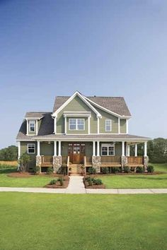 Perfect colors with wooden door and brown roof. LOVE the porch too.