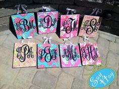 Monogram canvas gifts for bridesmaids to hang on their chairs at the wedding.