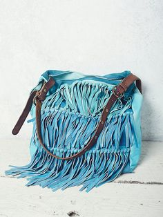 Salty Sea Fringe Tote | Buttery soft leather tote bag pieced with super luxe suede and features statement fringe detailing.  Inside has a magnetic top closure with zip and slip pockets.  Contrast and adjustable strap with metal stud accents.