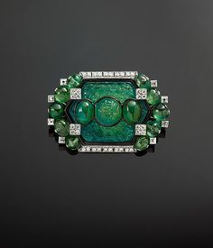 Brooch with Carved Emeralds and Diamonds by Cartier, circa modified by Cartier in Platinum, set with emeralds, diamonds and enamel. The Al-Thani Collection. Geek Jewelry, Gothic Jewelry, Indian Jewelry, Antique Jewelry, Fine Jewelry, Bullet Jewelry, Jewelry Necklaces, Turquoise Jewelry, Turquoise Bracelet