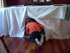 Building forts with couch cushions, pillows, chairs, tables and lots and lots of blankets is a classic childhood indoor activity — but can also be fun as an adult
