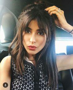 Long hair brunette fringe bangs half up half down glossy shine credit: sazan hendrix ig