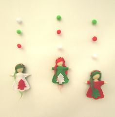 """Handmade Set Fairies ornaments for Christmas tree decoration. Fairy is a magical creature that is born from a flower. She has a gentle heart, helping everyone and making dreams come true. She spreads magic dust everywhere she goes, and everyone who sees her falls in love with her. This set of 3 christmas Fairies ornaments is perfect for christmas gift or tree decoration The fairy made with felt and marino wool. Each fairy is about 5.5"""" (14 cm) long. She has an invisible thread attached to..."""