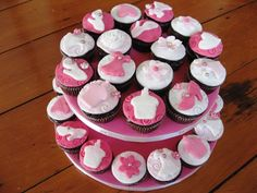 Opting for Cupcakes instead of Traditional Wedding Cakes...  Chose a variety of patterns in my theme color...something like this.