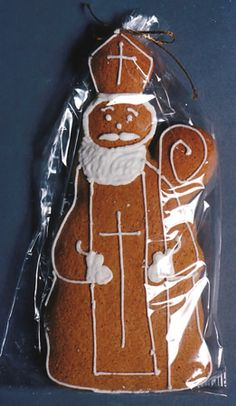 Speculatius (German Spice Cookie from Rhineland). Originally a dough recipe to be pressed into  wooden molds but can also be used with  cookie cutters or simply hand cut using a cardboard pattern of about 7 in. tall Bishop. (pattern for the Bishop is shown on this site as well).