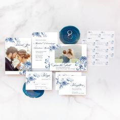 Flat lay of the complete Floral Wedding Suite from the Martha Stewart for Mixbook Collection featuring rings, an invitation, rsvp card, thank you card and more.