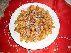 Struffoli Sweets – Another traditional Italian Christmas dessert, struffoli are sweet fried balls of dough served with a sugary glaze and dusted with powder sugar on top. Struffoli are simple to make, and will add an authentic Italian vibe to your holiday celebration.