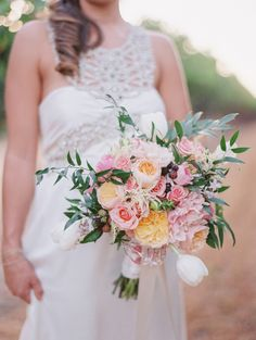 Colorful pink wedding bouquet: http://www.stylemepretty.com/california-weddings/geyserville-california/2016/01/17/french-inspired-wine-country-wedding-at-geyserville-inn/ | Photography: Lori Photo - http://loriphoto.com/