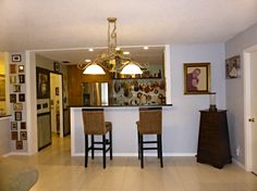 For this remodeling, we cut the wall between the kitchen and the family room to make a bar and open up the kitchen.  We also hung the chandlier and renovated the kitchen.  To see more of our work click on pin.