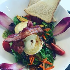 Yummie salad with sweet potatoe, goat cheese, bacon and red cabbage