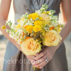Beautiful yellow bridesmaid bouquets :)