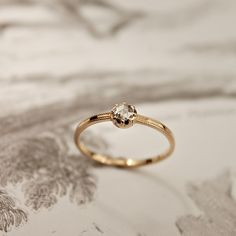 Small diamond in rose gold setting, thin band ...love simple
