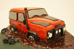 Land Rover Defender cake. Lemon sponge with vanilla buttercream and dark chocolate ganache mud.
