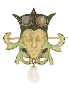 Art Nouveau Jester brooch, by René Lalique, France, 1897/1898. Composed of gold, translucent enamel and baroque pearl.