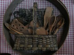 love this basket of old wooden utensils inside the antique sifter ****