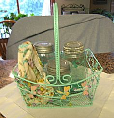 Antique Ball Mason Jars with metal basket and cute child's apron for sale at More Than McCoy at www.morethanmccoy.com