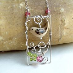 Bird in a Garden - Mixed Media Necklace (Ruth Jensen) Tags: bird necklace mixedmedia jewelry sterling swarovski wiresculpture handcarved argentium birdnecklace sparkflight ruthjensen Wire Wrapped Jewelry, Metal Jewelry, Beaded Jewelry, Jewelry Chest, Jewelry Shop, Mixed Media Jewelry, Jewelry Logo, Jewelry Rings, Fashion Jewelry