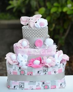 Pink Grey Elephant Diaper Cake with Receiving Blankets, Baby Socks, Spoons, and Washcloths