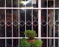 Diamond shaped iron fence behind İstiklal Caddesi