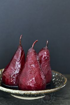 These Red Wine Poached Pears make an elegant and delicious dessert served with its reduced syrupy spiced poaching liquid. Definitely a must-try! | Food to gladden the heart at RotiNRice.com