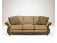 "Shop for Signature Design by Ashley Sofa, 3940138, and other Living Room Sofas at Hickory Furniture Mart in Hickory, NC. With sweeping rolled arms on either side of supportive yet comfortable seating cushions along with the beauty of the deeply detailed showood, The ""Cambridge-Amber"" upholstery collection is a shining example of the elegance and comfort that comes with exceptionally designed traditional furniture."