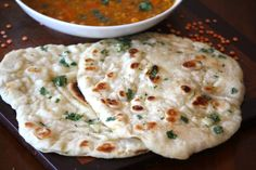 Homemade Naan with Garlic & Cilantro. I put this in my baking file but it's really done in a cast iron skillet.  http://www.alaskafromscratch.com/2012/09/24/homemade-naan-with-garlic-cilantro/