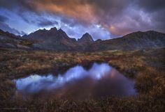 """Stormy Solbjornvatnet - An approaching storm at dusk near a beautiful mountain-lake area in Lofoten. This nearby pool reflected some of the brief last moments of light on this quiet, enjoyable evening.  Best if viewed on a desktop, as for some reason it is not showing up the same on my phone.   <a href=""""https://www.facebook.com/CandaceBartlettPhotography"""">Follow me on Facebook</a> <a href=""""www.candacedyar.com""""> Website</a> <a href=""""https://instagram.com/candacedyar/""""> Instagram</a>"""