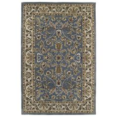 The Royal Taj Blue area rug captivates with its timeless Oriental-inspired pattern design. Hand-tufted in India from the finest 100-percent washed virgin wool, this inviting rug is a work of art showcasing an extremely soft finish.