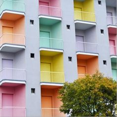 Pastel doors on apartment building