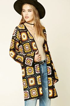 An open knit cardigan featuring a geo pattern, open front, long sleeves, and a longline silhouette.