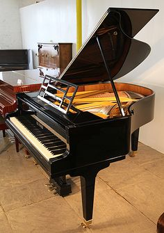 A restored, 1931, Bluthner grand piano with a black case #bluthner