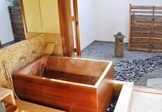 """Japanese soaking tubs are known as """"ofuro."""" They are much deeper compared to the traditional western bathtub. Ofuro tubs are traditionally made of Hinoki Japanese Bathtub, Japanese Soaking Tubs, Outdoor Baths, Outdoor Bathrooms, Luxury Bathrooms, Modern Bathrooms, Small Bathrooms, Indoor Outdoor, Small Soaking Tub"""
