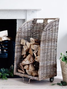 Woven from natural hardwearing rattan with a tall back and two cut out handles, our Rattan Log Trolley is the ideal companion for anyone with a real log fire. This clever large trolley includes two wheels at the base to let you stack a large bundle of logs and kindling and carry them straight from storage to the fireplace.