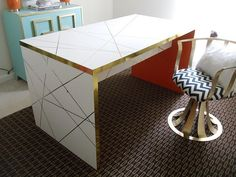 a plain wooden desk gets tricked out with a new white and gold exterior. do this with the TV stand?? LOVE IT